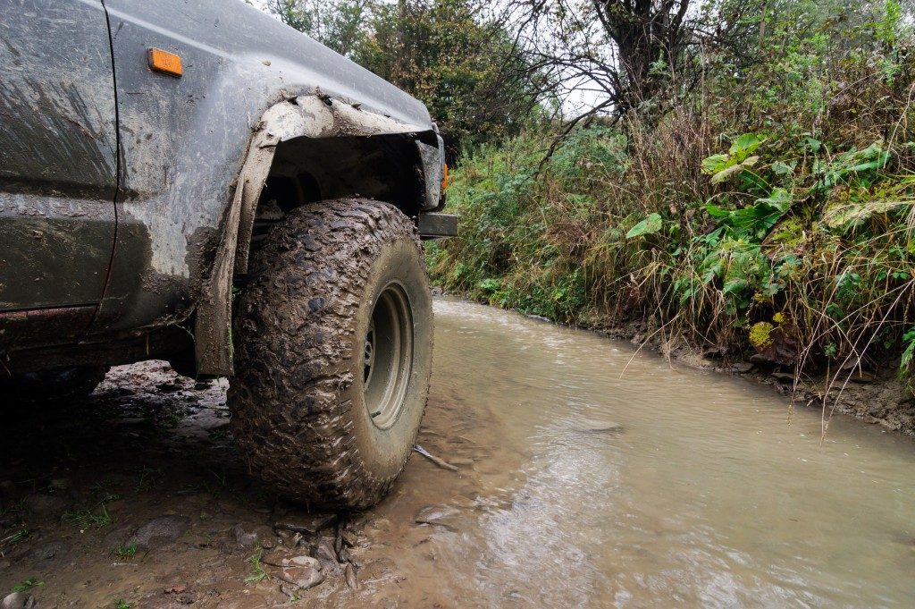 A 4WD by a muddy road