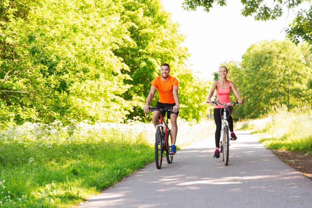 Couple biking on the park