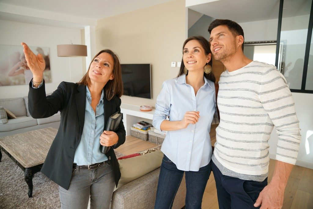 a real estate agent touring a couple