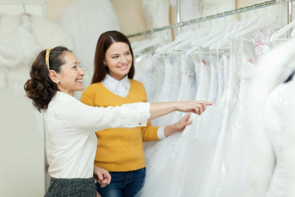 a soon-to-be bride choosing her wedding gown