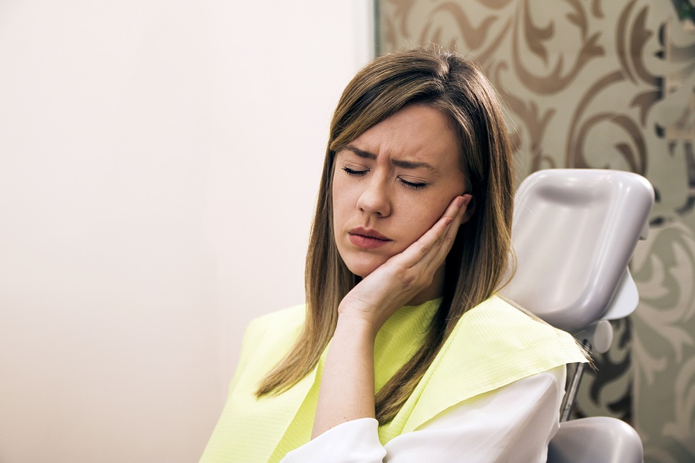 a woman having tooth pain
