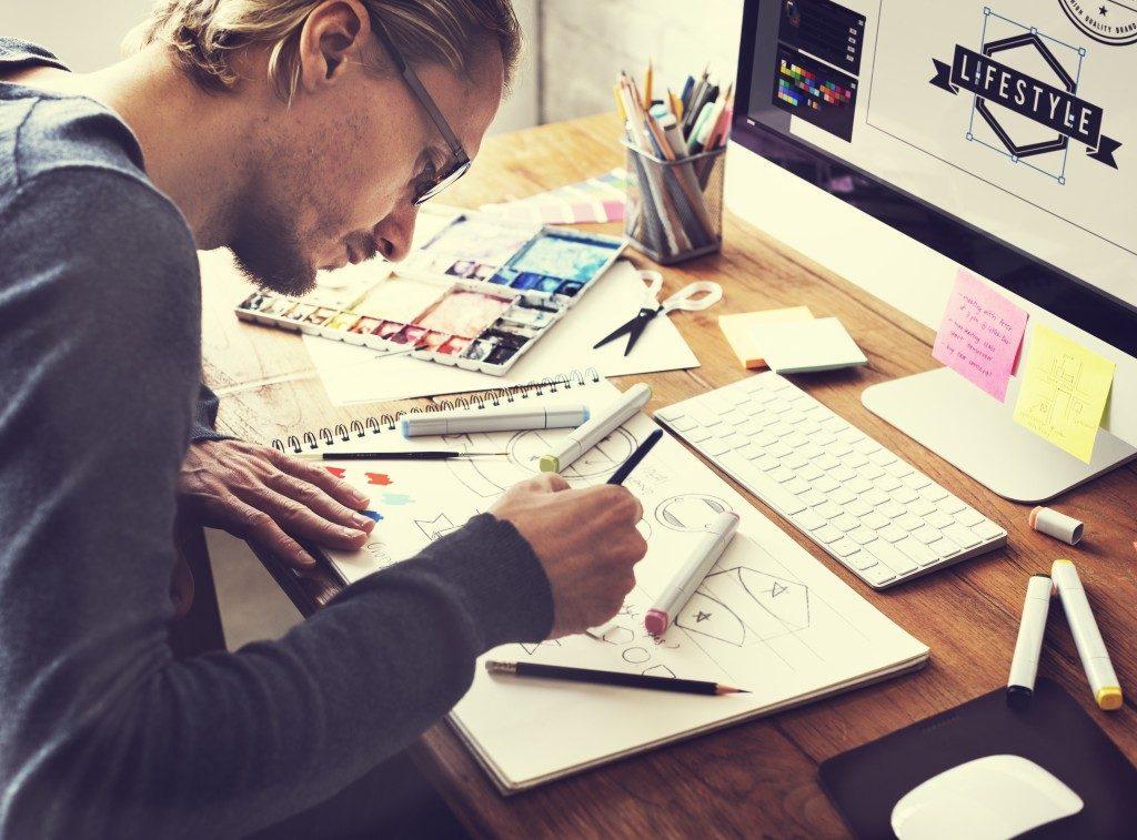 Designer drawing at work