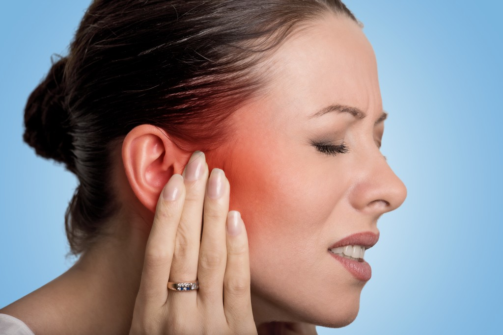 Woman having ear pain