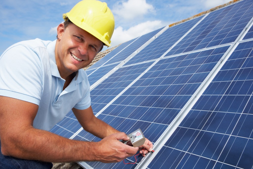 engineer checking solar panels