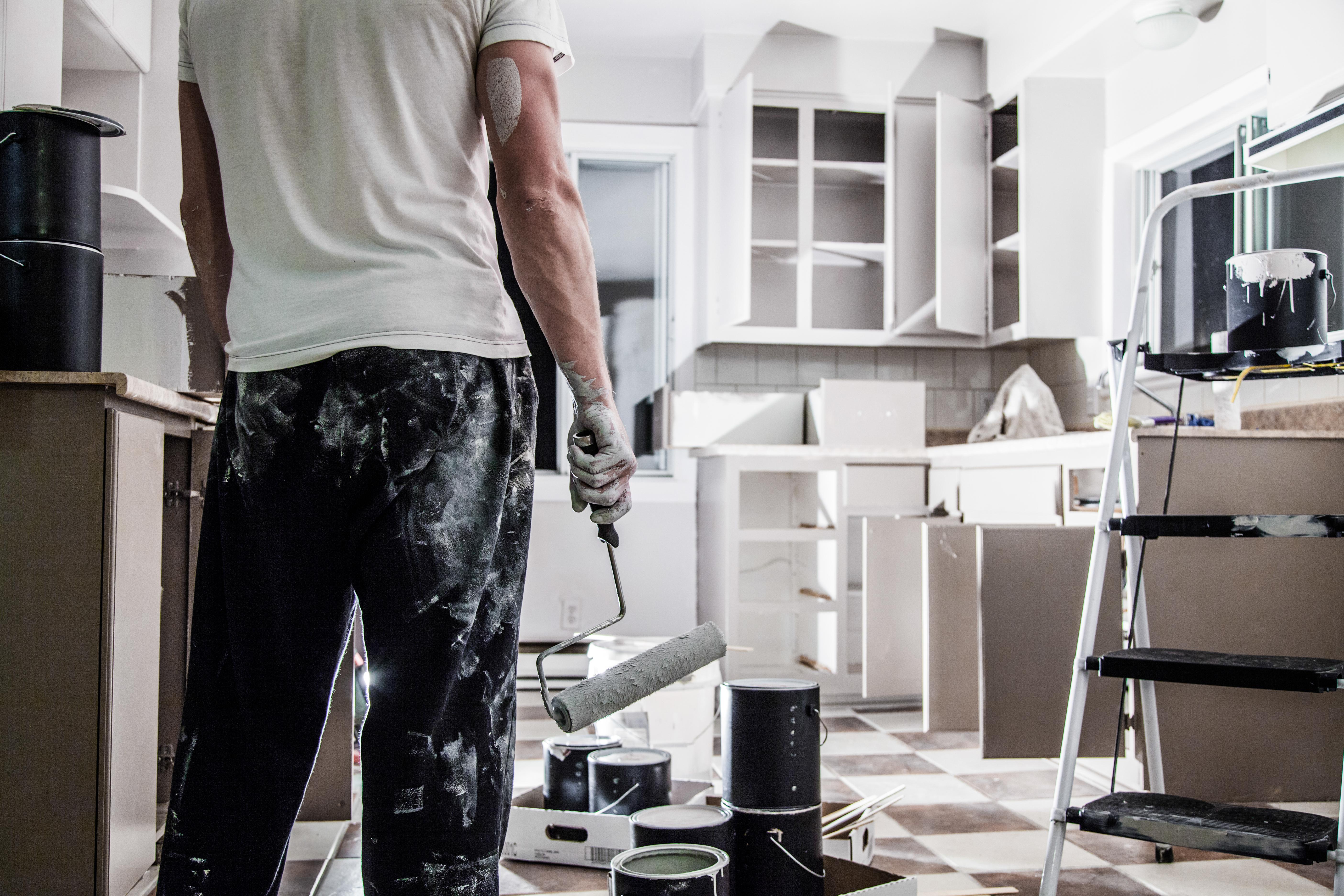 man repainting kitchen