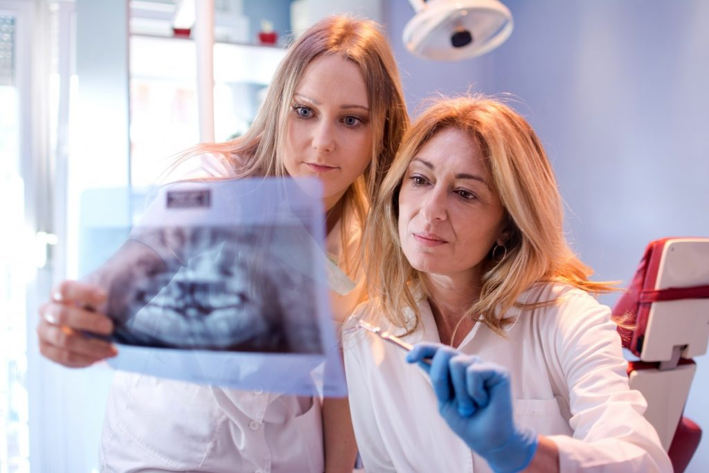 Dentists looking at an x-ray