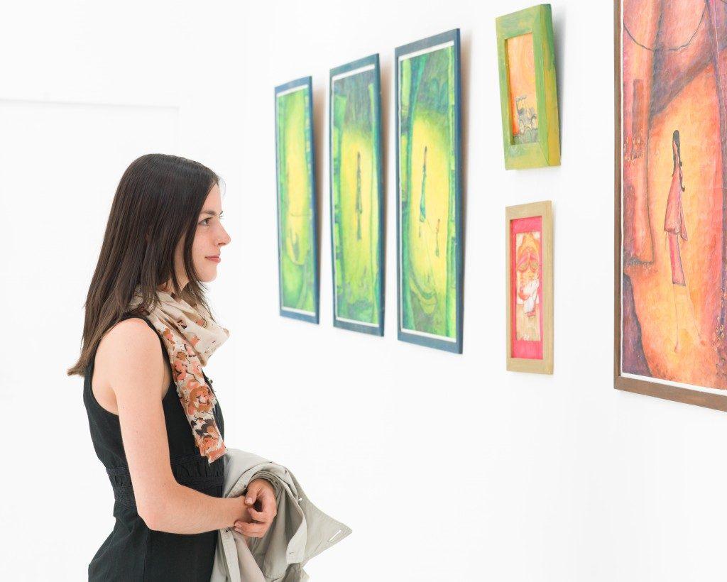 Woman looking at art