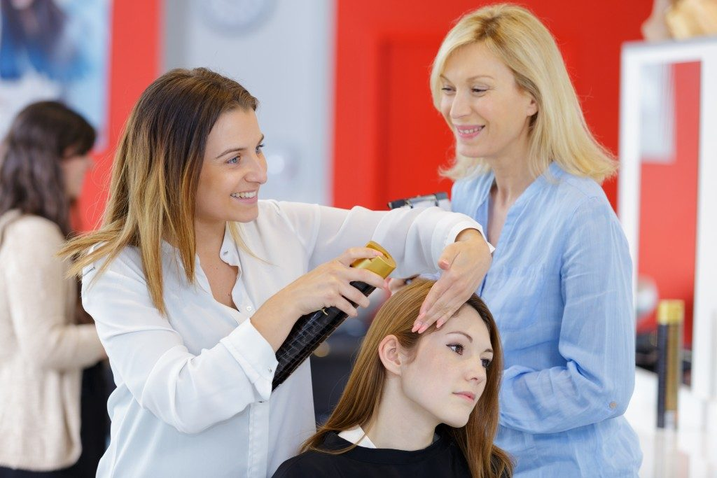 woman receives treatment of hair