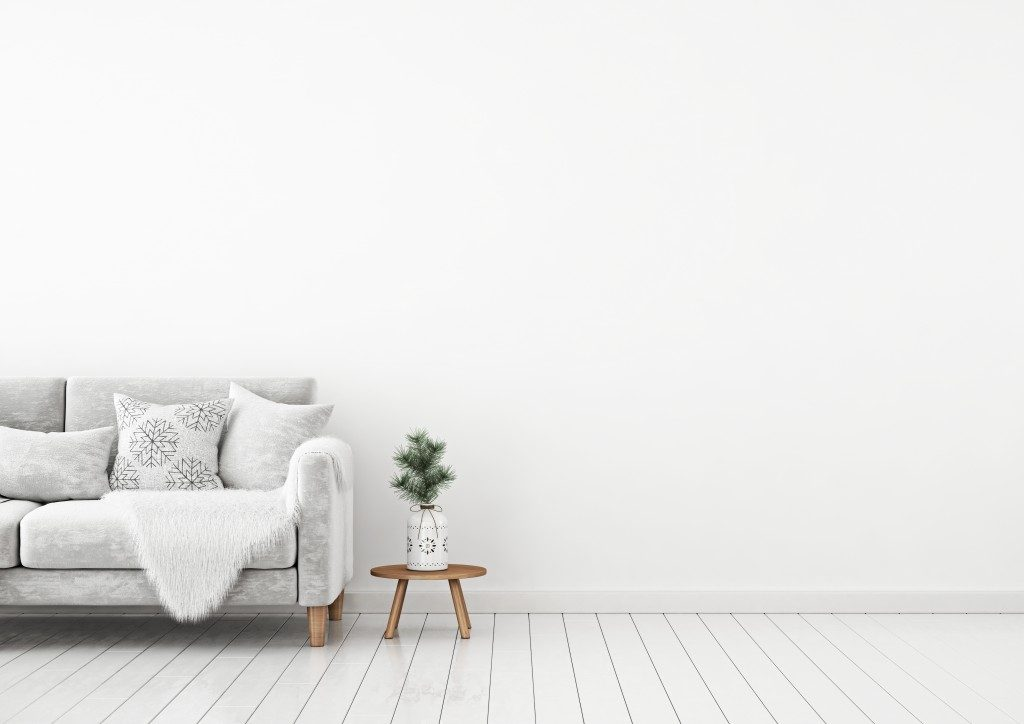 white interior living room with a grey sofa and side table