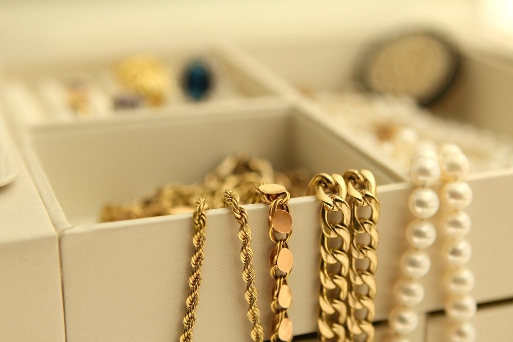 Gold jewelry and pearls in a box