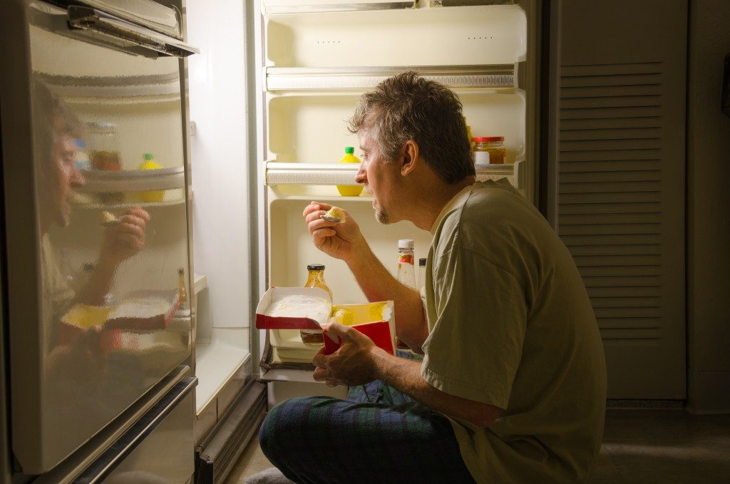 man eating in the middle of the night