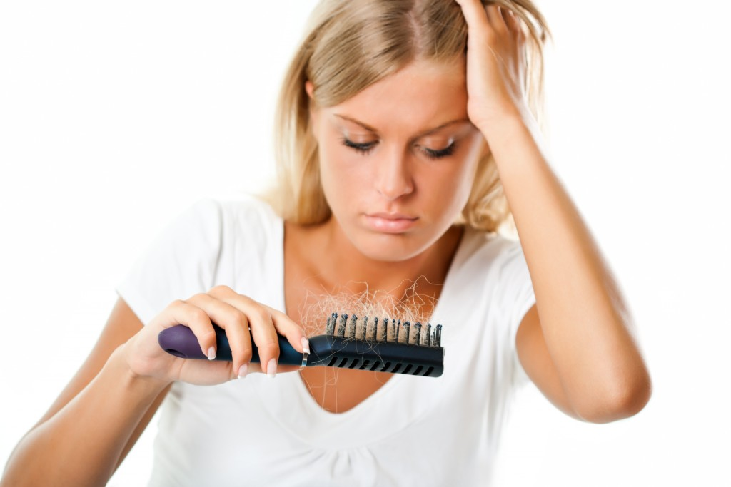 Woman worried about hair loss