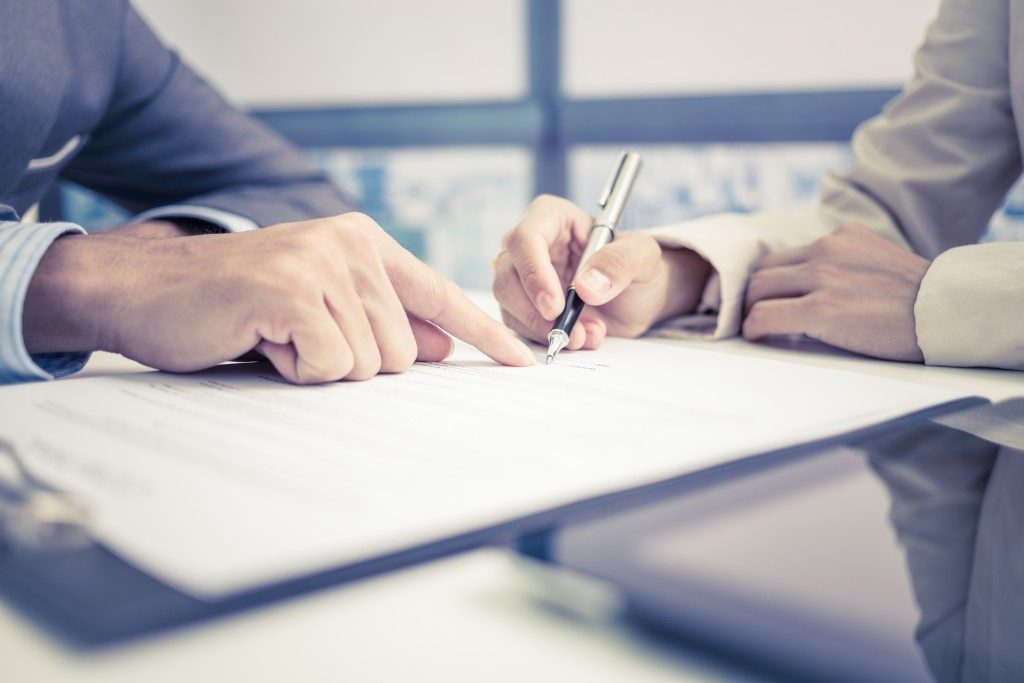 Man signing insurance contract
