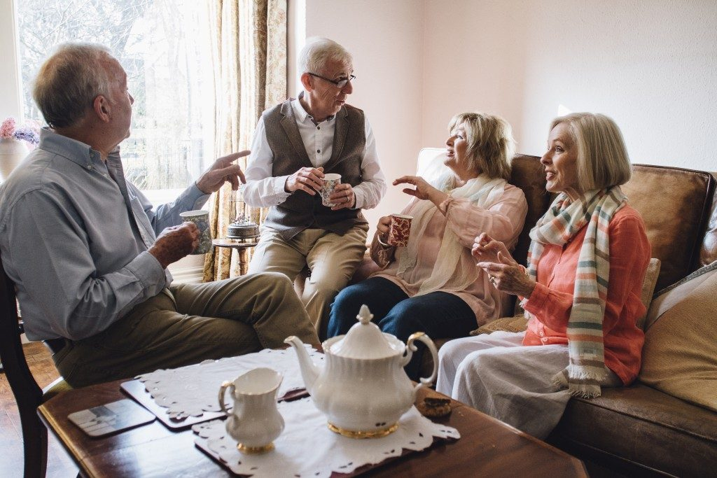 Seniors chatting in a nursing home facility