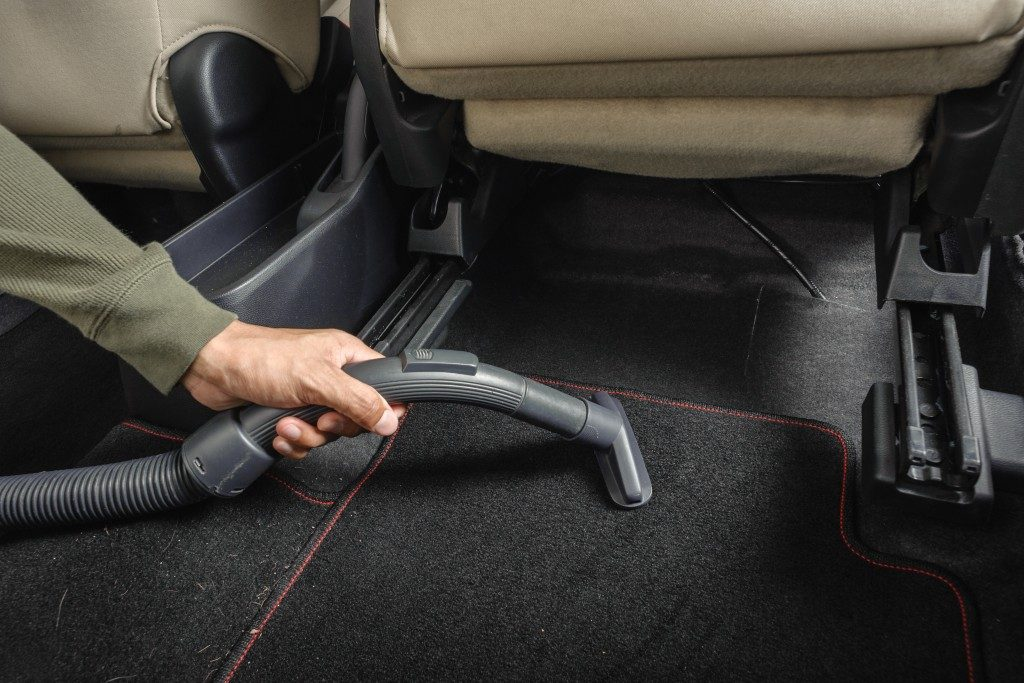 cleaning car with vacuum clean