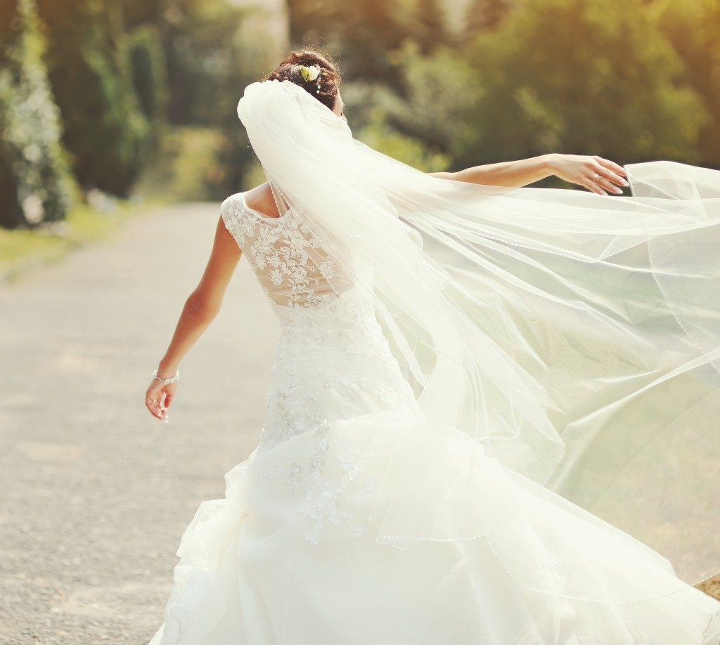 Bride spinning around with veil