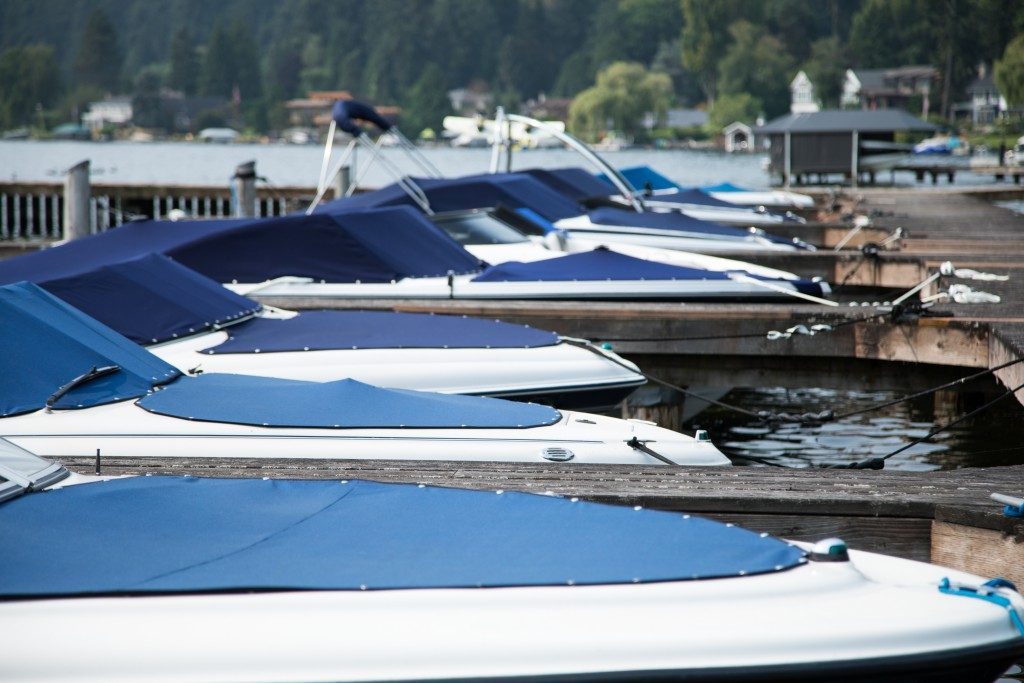 motor boats parked at the dock