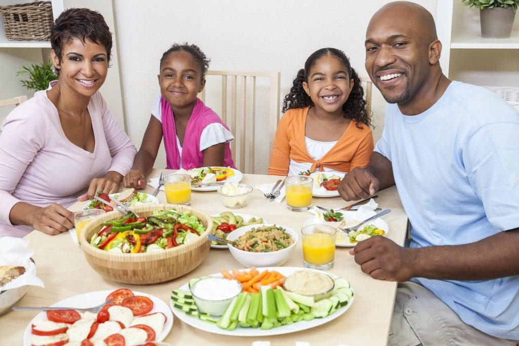 Family enjoying healthy meal at home