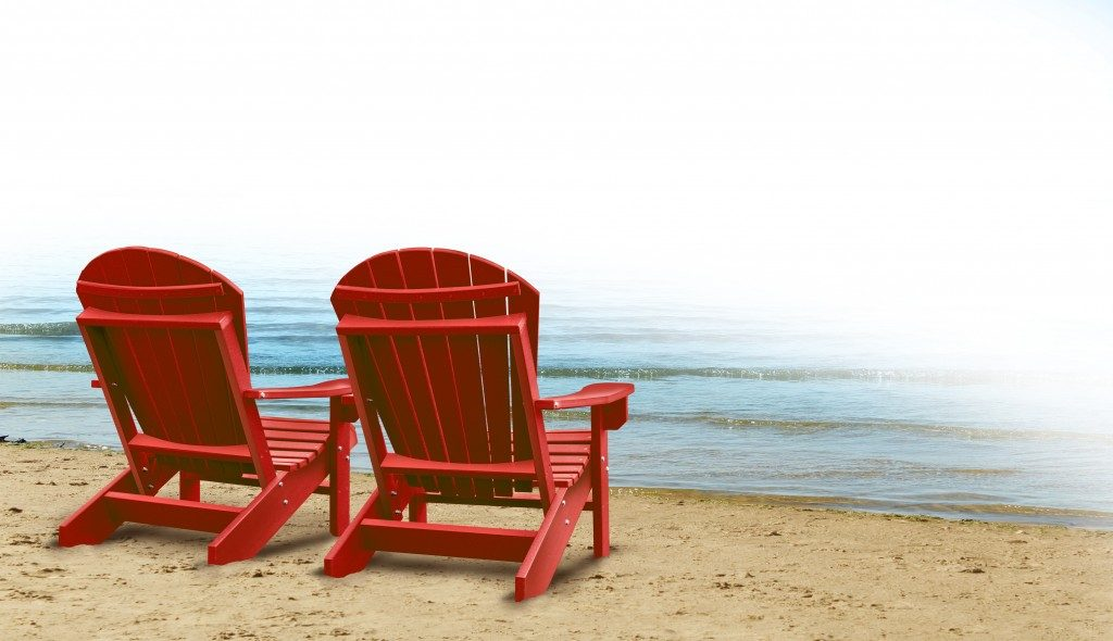 wooden chairs by the beach