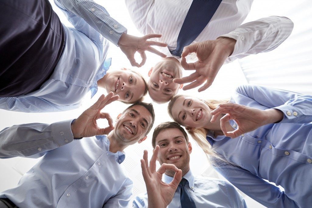 employees giving an ok sign