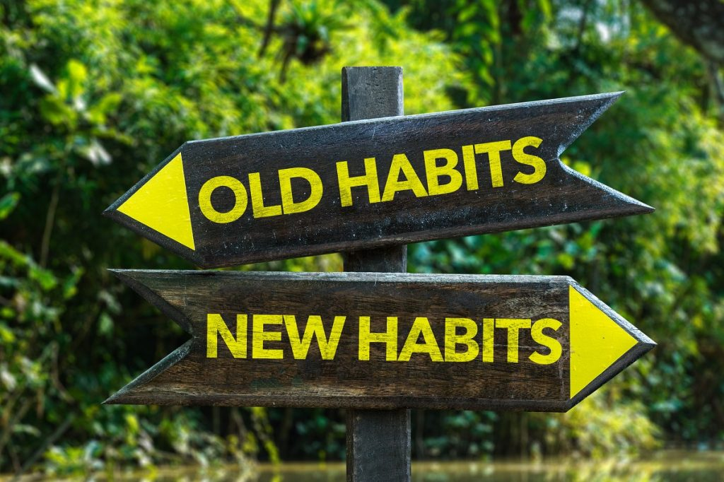 old and new habits road sign