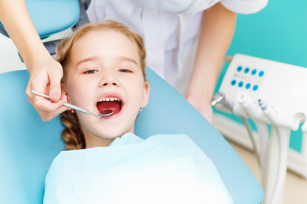 child with the dentist