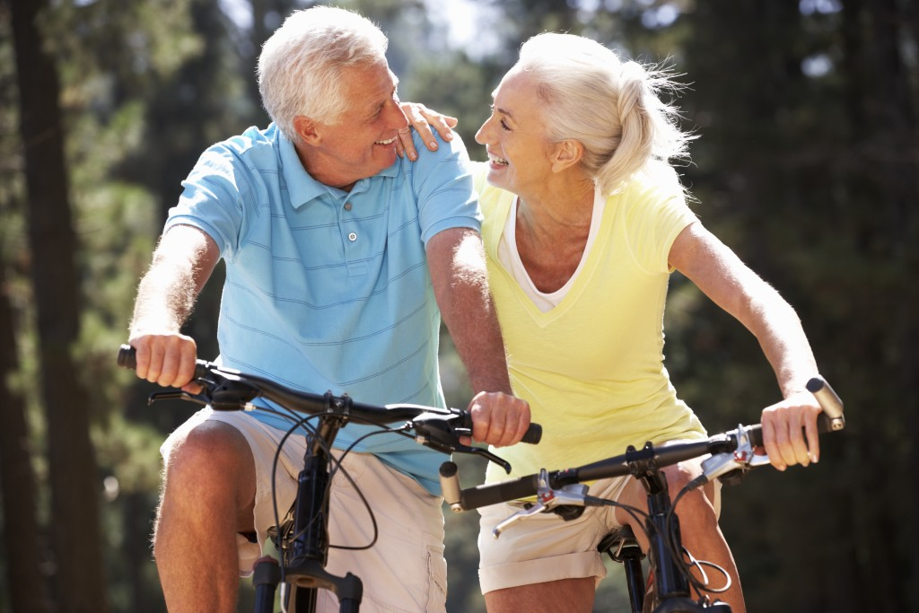 senior couple riding a bike