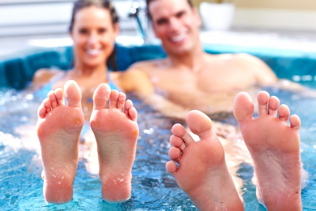 Young relaxed couple in jacuzzi
