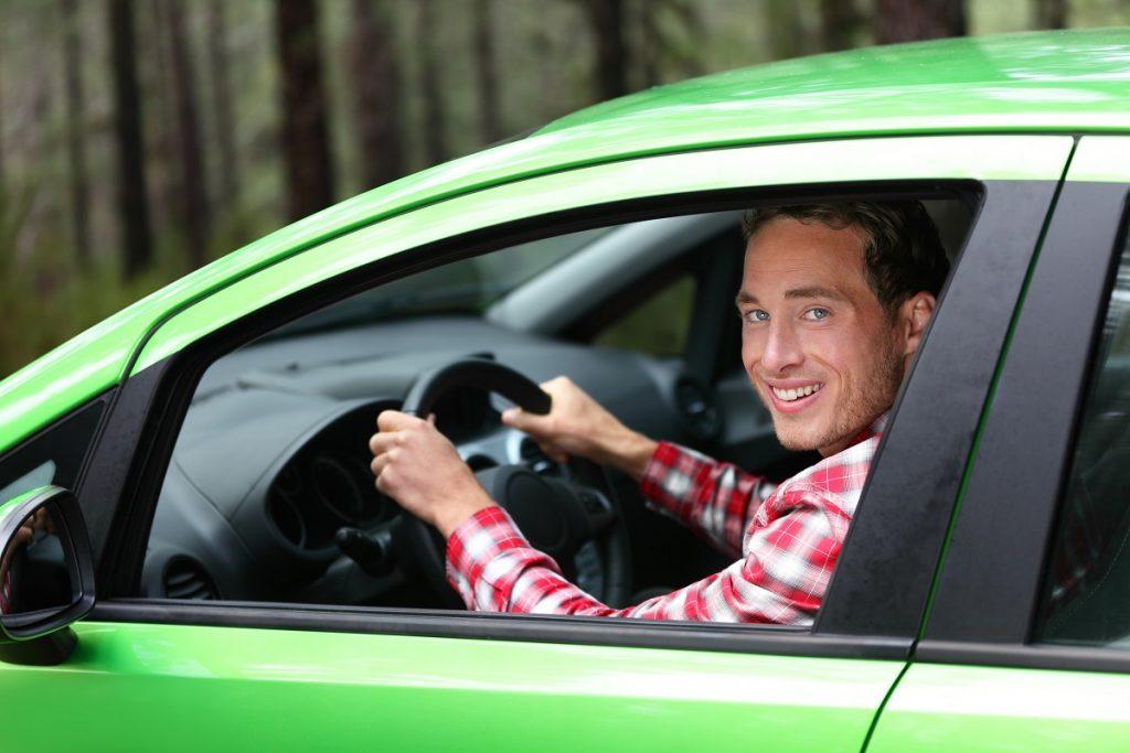 man inside green car