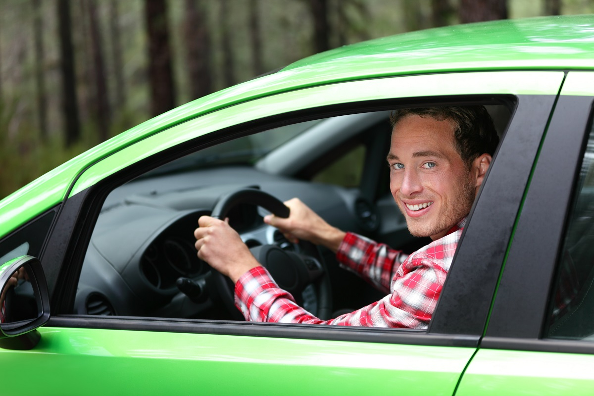man inside green car