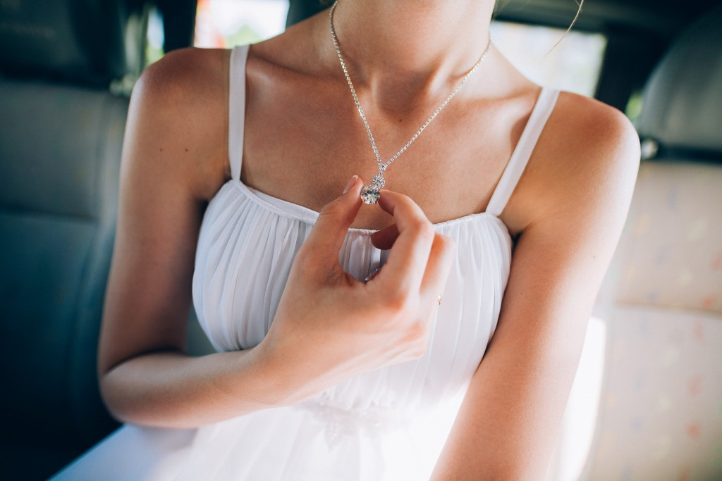 Girl in white dress wearing necklace