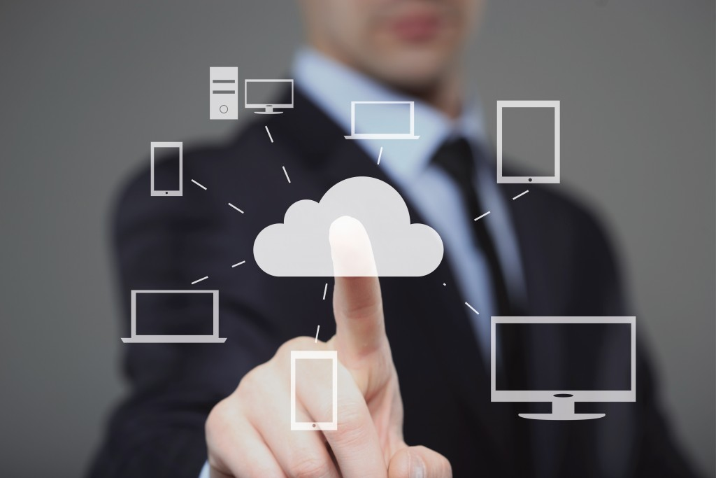 man touching cloud graphic