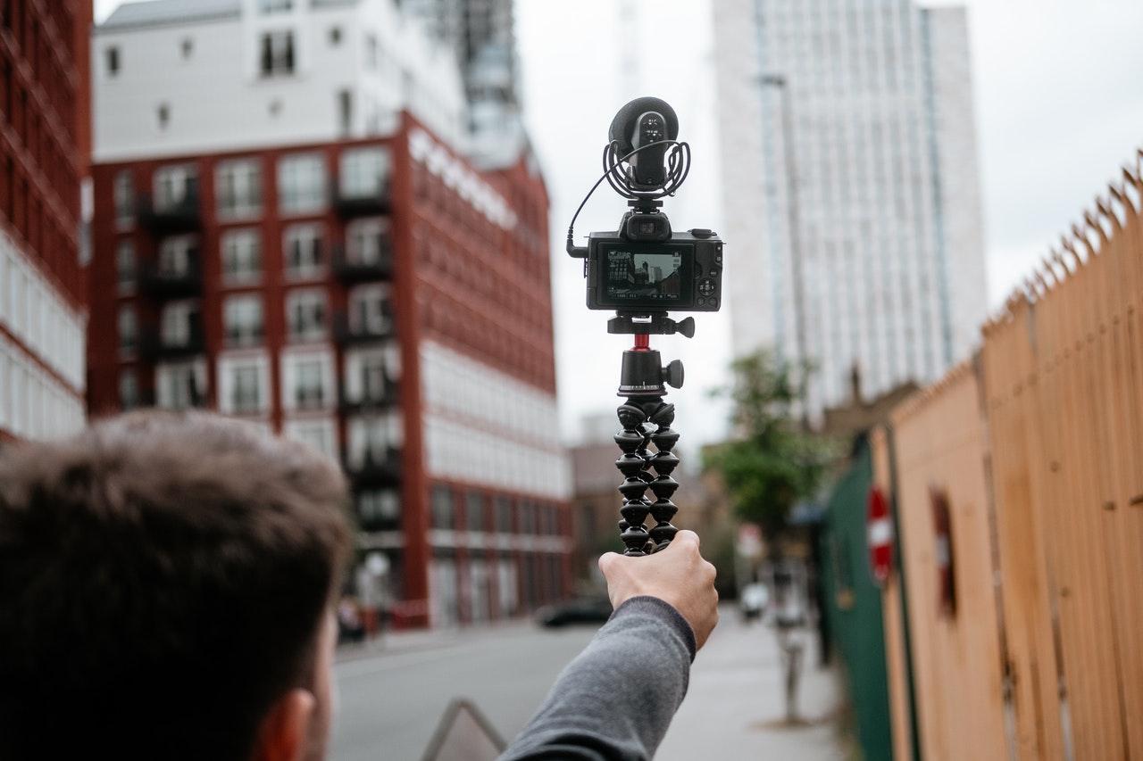 man filming blogs