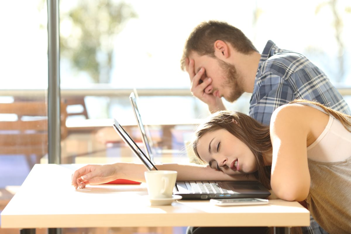 man tired and woman sleeping