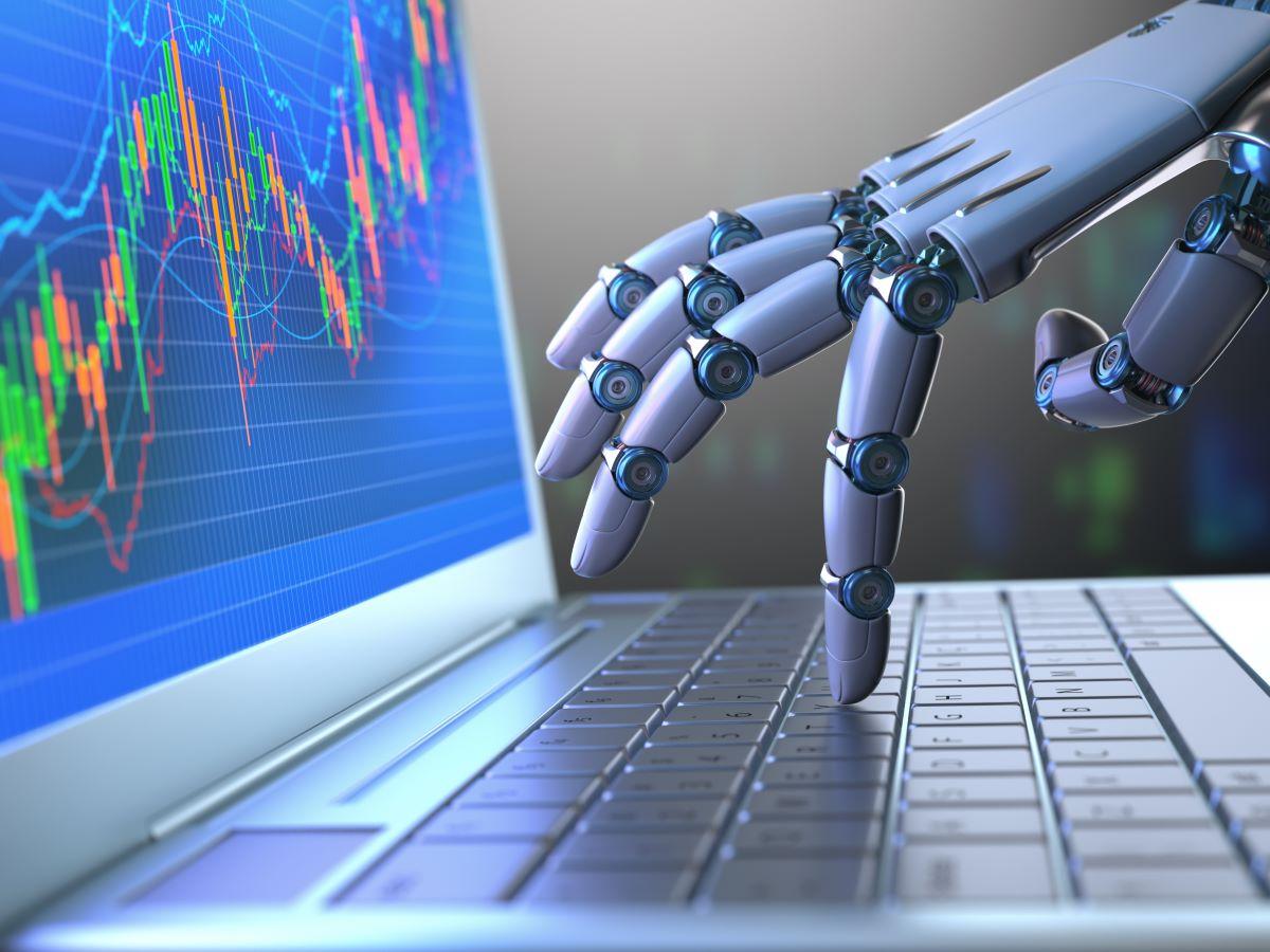 robot pressing keys on laptop