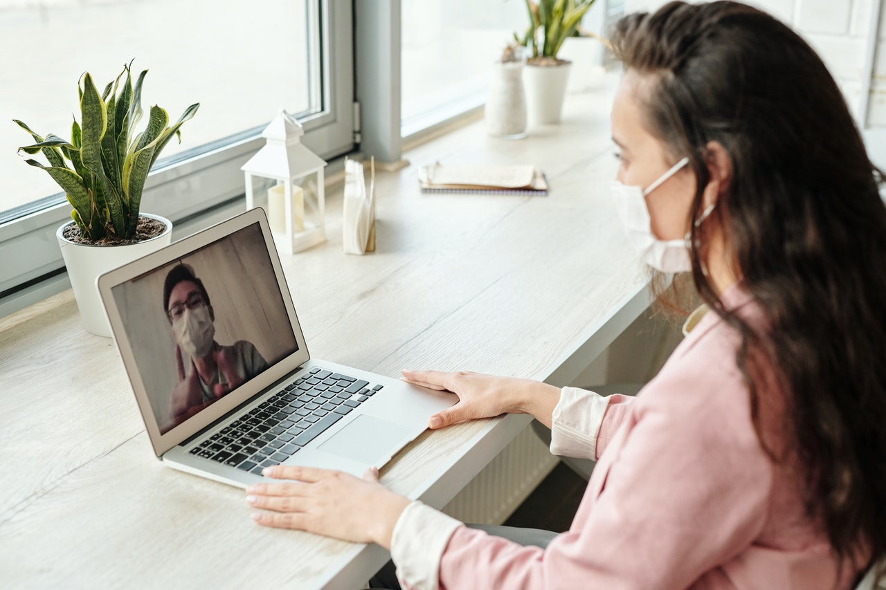 video call meeting while both participants are wearing face masks