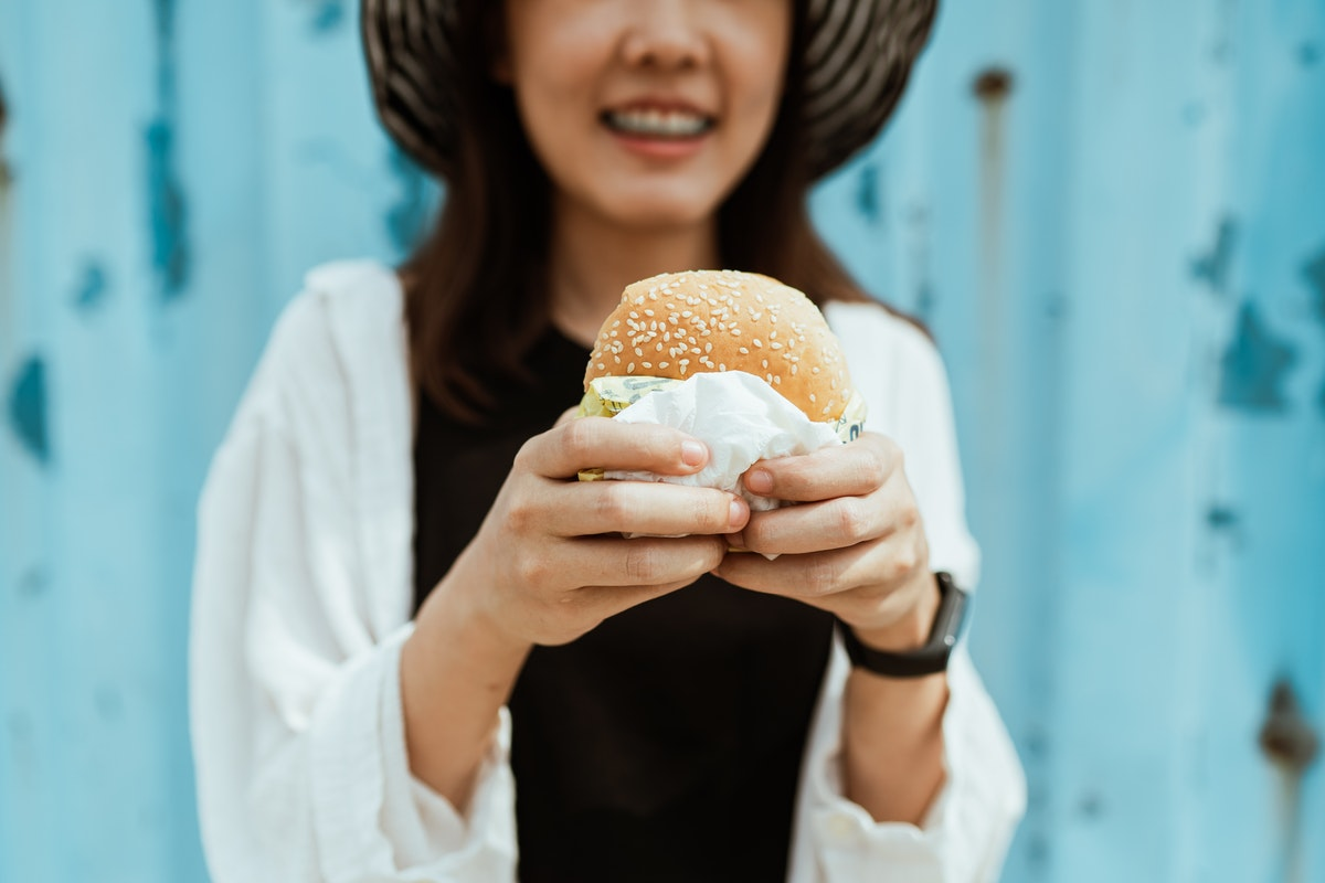 holding a burger