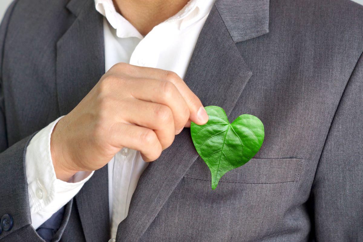 man holding heart shaped leaf