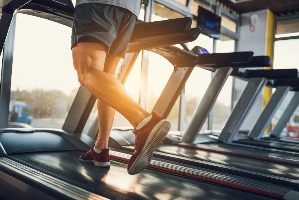 man using treadmill